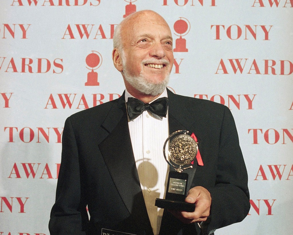 """Harold Prince holds his award for best director in a musical for """"Show Boat"""" at the Tony Awards in New York on June 4, 1995. Prince, who pushed the bo..."""