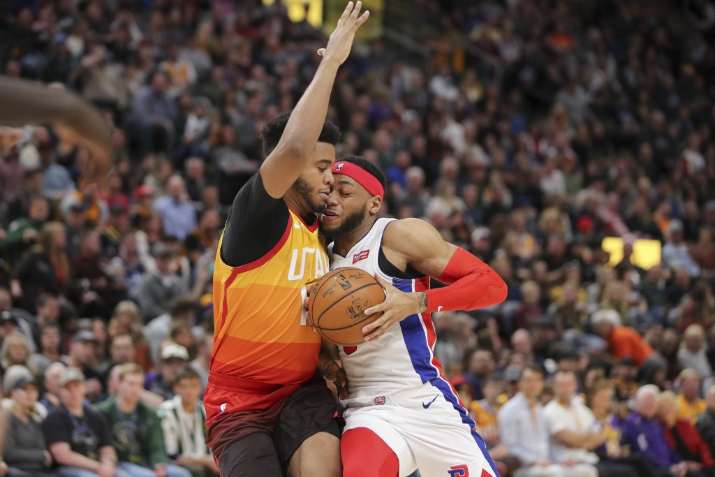 Detroit Pistons guard Bruce Brown, right, and Utah Jazz forward Juwan Morgan, left, collide as Brown tries to get to the basket during the second quar...