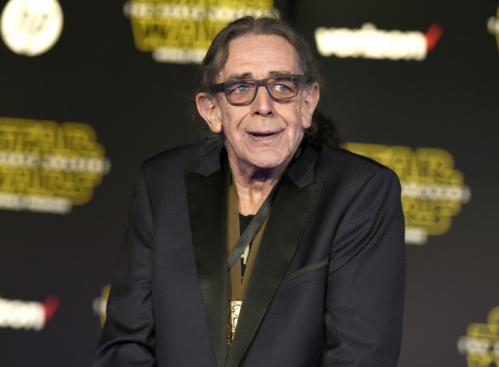 """Peter Mayhew arrives at the world premiere of """"Star Wars: The Force Awakens"""" in Los Angeles on Dec. 14, 2015. The towering actor, who played Chewbacca..."""