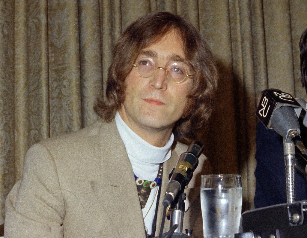 FILE - In this 1971 file photo, singer John Lennon appears during a press conference. Newly public documents released Tuesday, Dec. 31, 2019 reveal th...