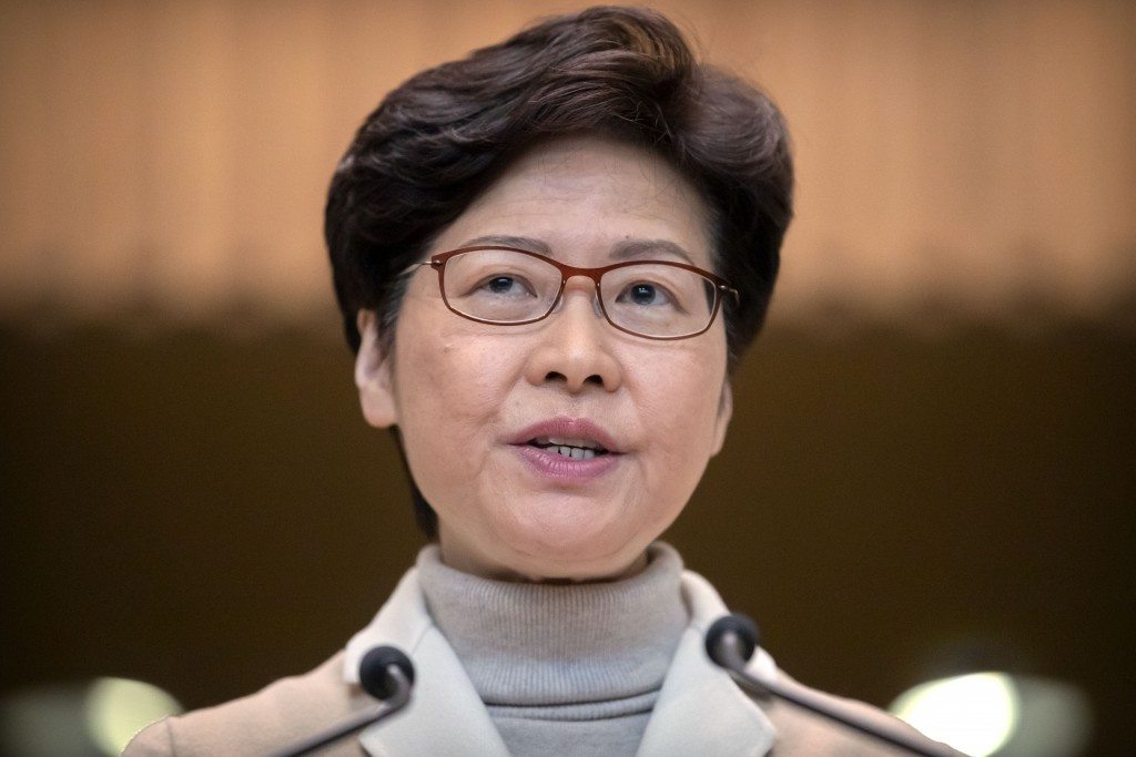 FILE- In this Dec. 10, 2019, file photo, Hong Kong Chief Executive Carrie Lam speaks during a news conference at the Office of the Chief Executive in ...