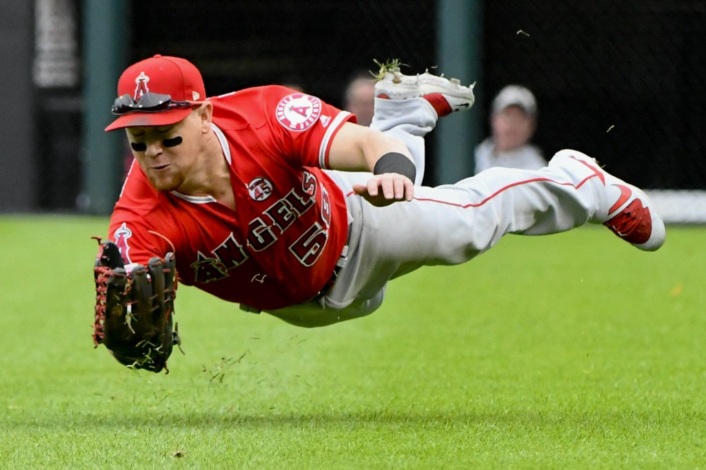 File-This Sept. 8, 2019, file photo shows Los Angeles Angels right fielder Kole Calhoun (56) catching a ball hit by Chicago White Sox's James McCann d...