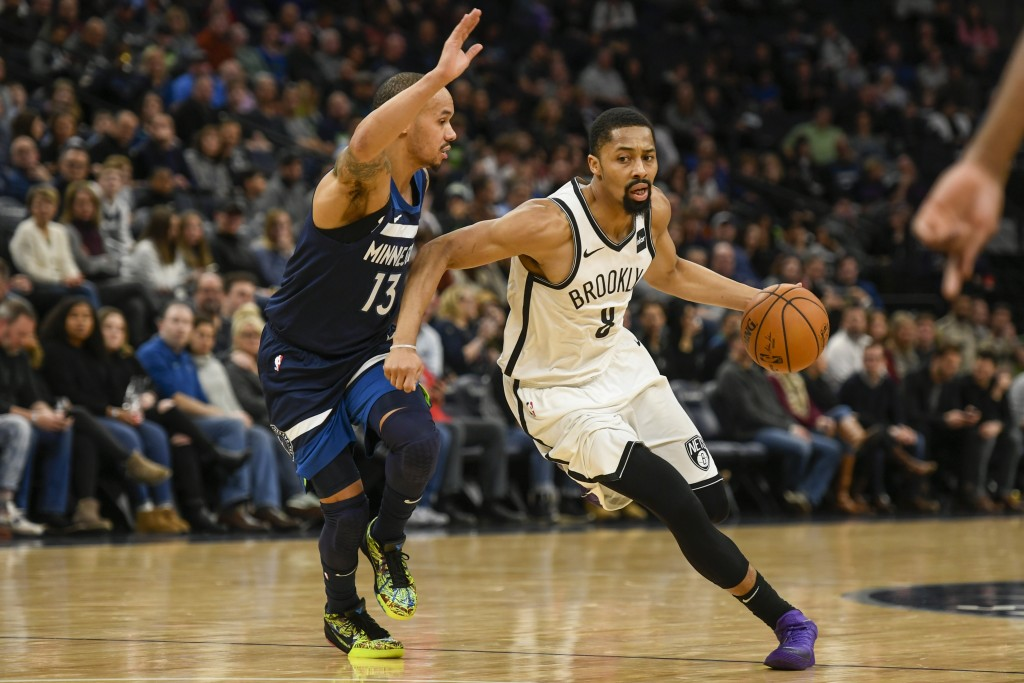 Brooklyn Nets guard Spencer Dinwiddie, right, drives past Minnesota Timberwolves guard Shabazz Napierduring the first half of an NBA basketball game ...