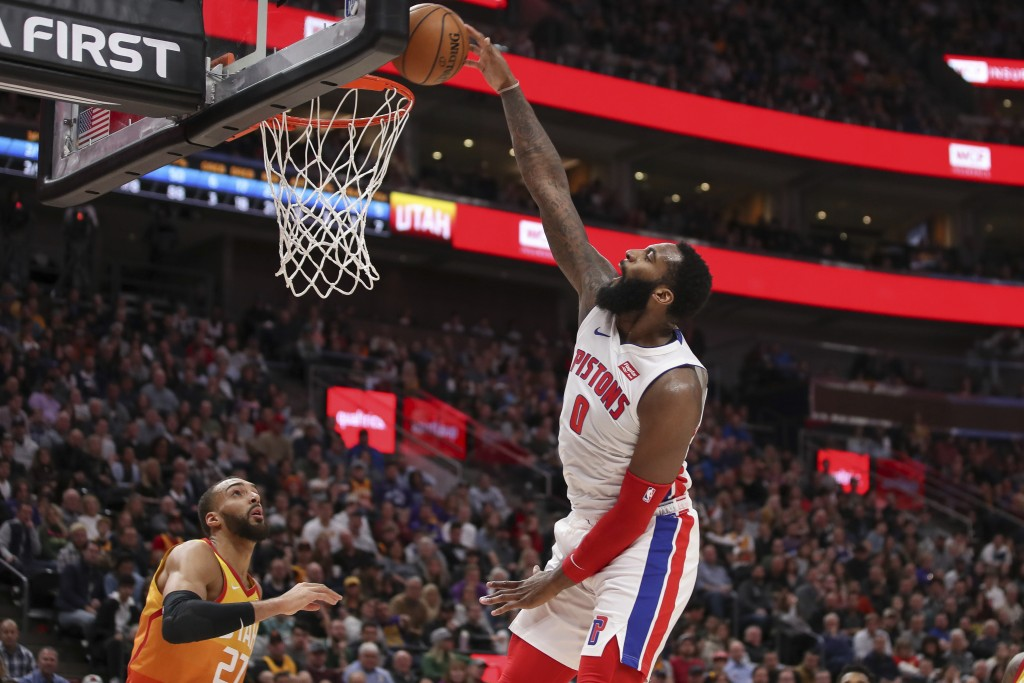 Detroit Pistons center Andre Drummond (0) attempts to dunk against the Utah Jazz during the second quarter of an NBA basketball game, Monday, Dec. 30,...