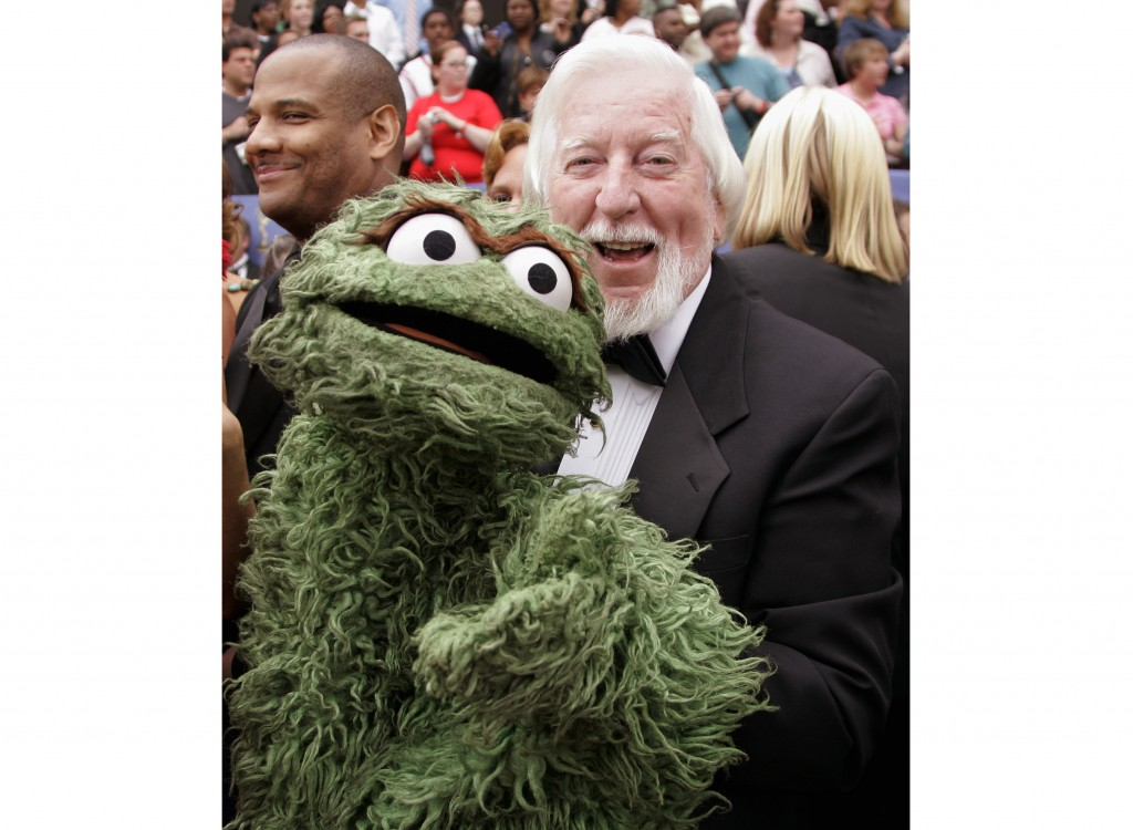 """Caroll Spinney, the puppeteer who plays the roles of Big Bird and Oscar the Grouch on """"Sesame Street,"""" arrives holding the Oscar the Grouch puppet at ..."""