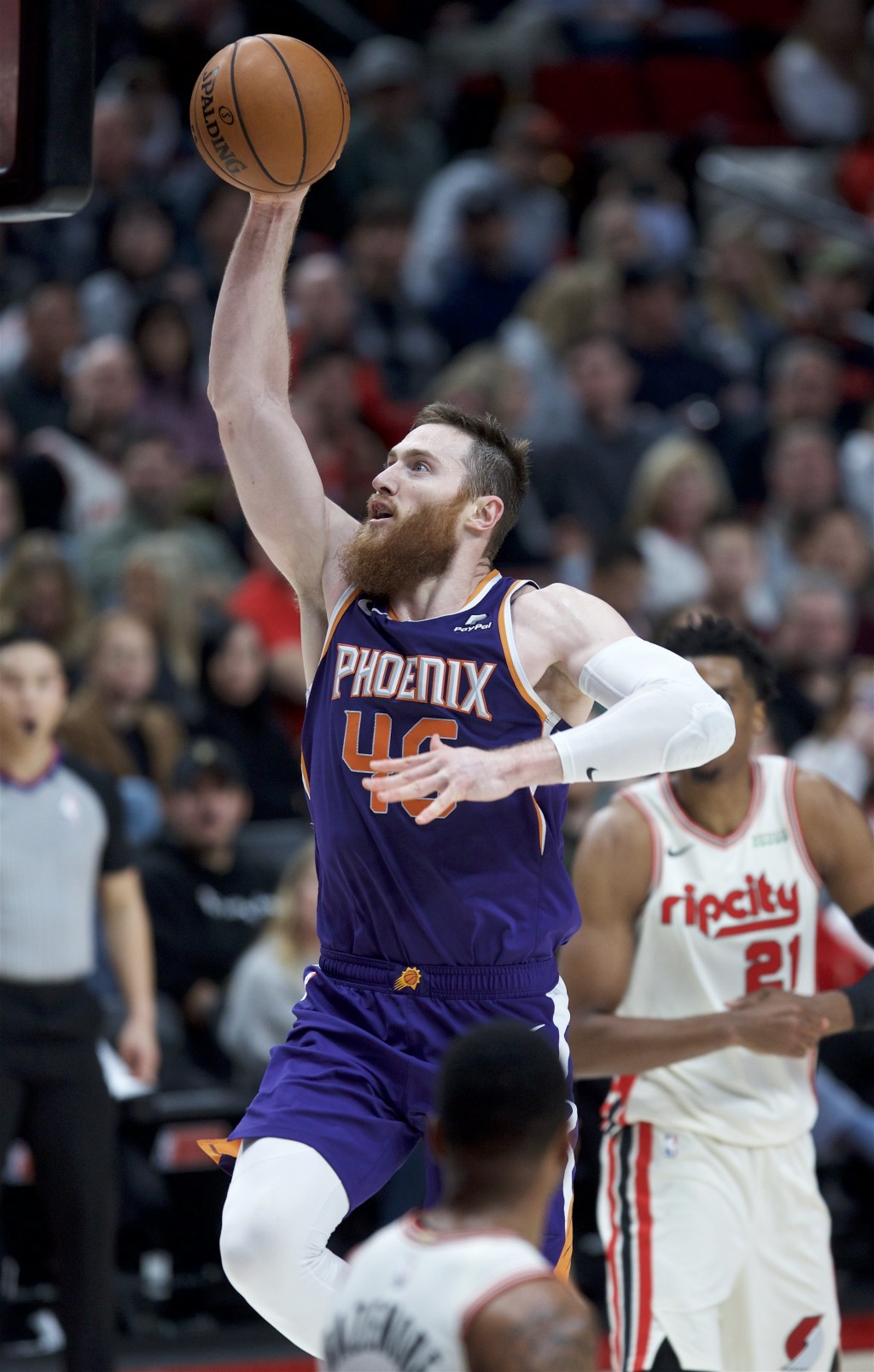 Phoenix Suns center Aron Baynes shoots against the Portland Trail Blazers during the second half of an NBA basketball game in Portland, Ore., Monday, ...