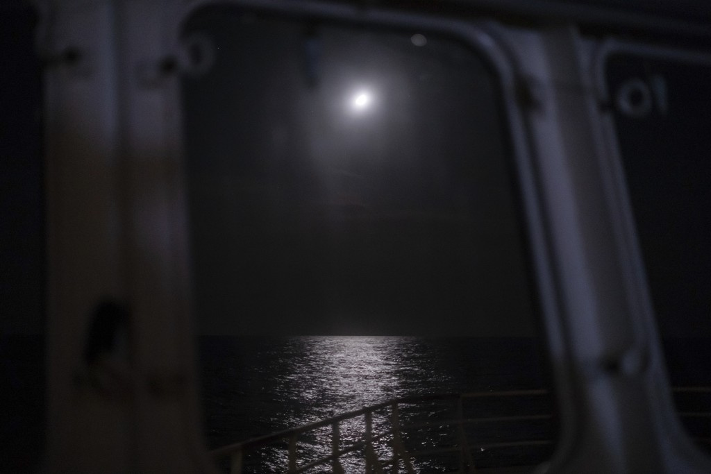 In this Sept. 7, 2019 photo, moonlight reflects from the surface of Mediterranean Sea off the coast of Libya. Husni Bey, a prominent Libyan businessma...