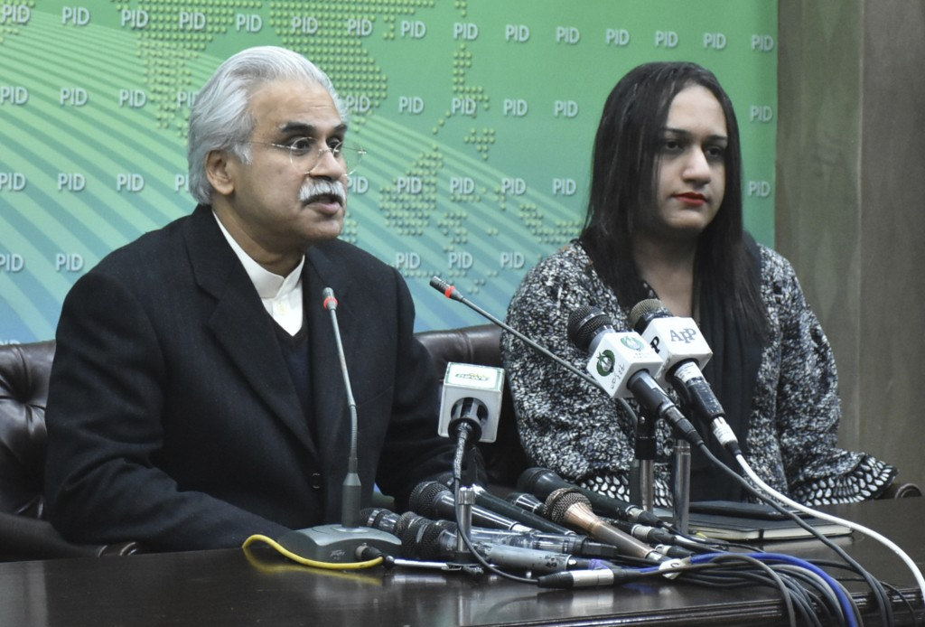 Dr. Zafar Mirza, left, Special Assistant to the Prime Minister on National Health, addresses a news conference with members of the Pakistani transgend...