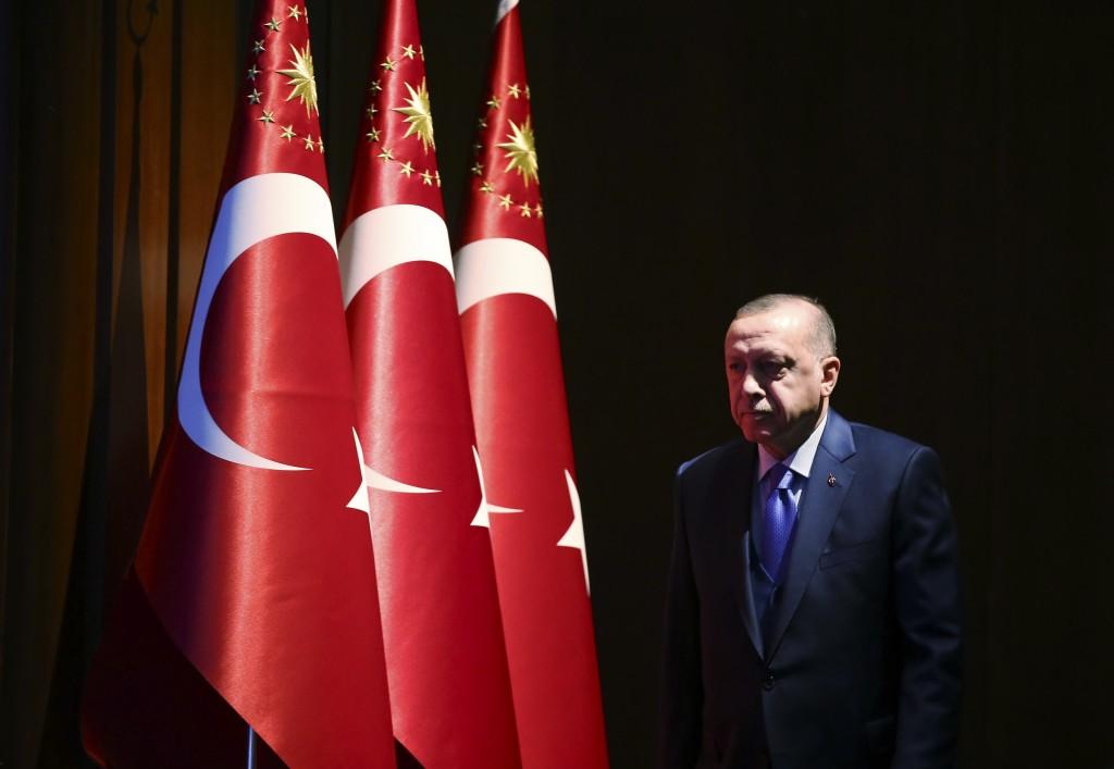 Turkey's President Recep Tayyip Erdogan arrives to deliver a speech at an event in Ankara, Turkey, Monday, Dec. 30, 2019. Turkey's government on Monda...