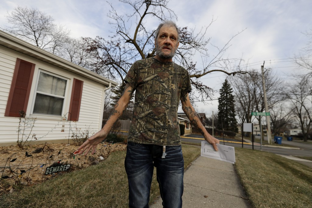 In this Friday, Dec. 20, 2019 photo, Bobby Goldberg walks in front of his home in suburban Chicago. Goldberg has filed a lawsuit claiming he was abuse...