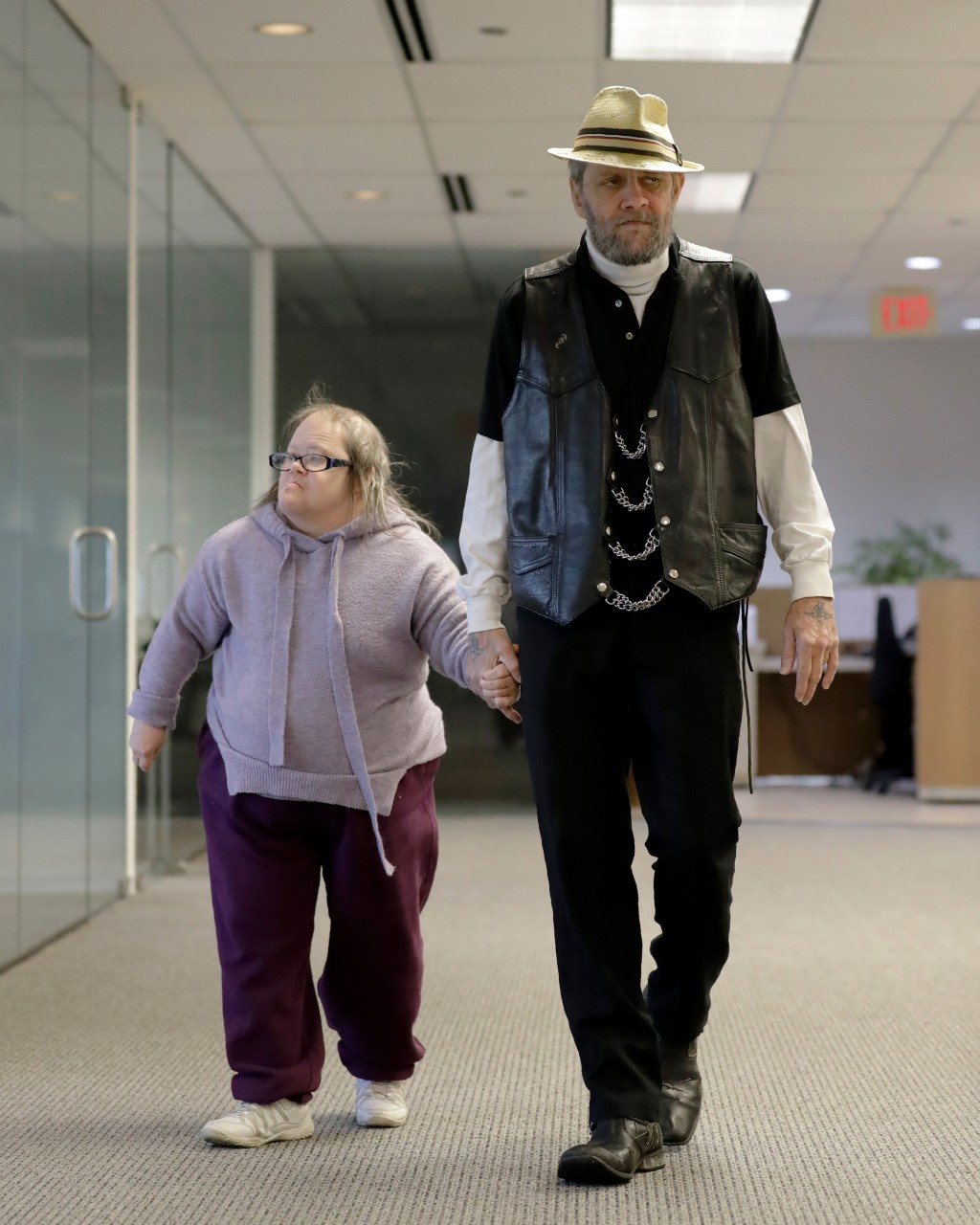 In this Saturday, Dec. 21, 2019 photo, Bobby Goldberg and his sister Debbie arrive at the office of his lawyer, Melissa Anderson, in Bannockburn, Ill....