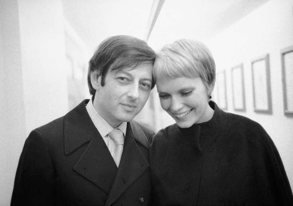 Andre Previn and actress Mia Farrow leave Carnegie Hall in New York after Previn conducted the London Symphony Orchestra on on April 30, 1969. The pia...