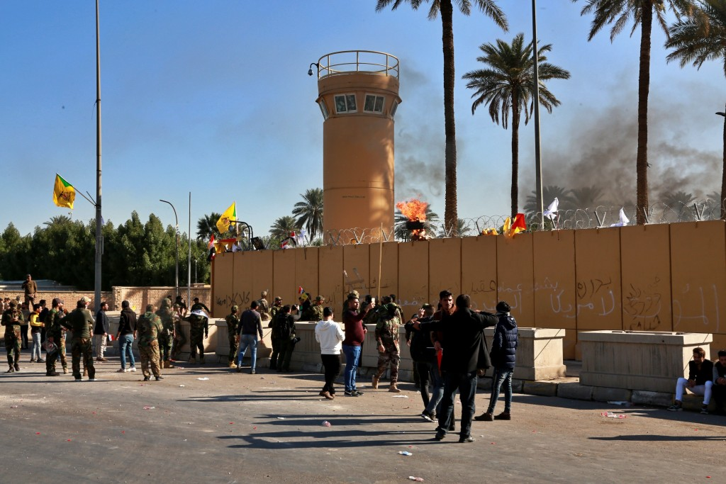 Protesters gather in front of the U.S. embassy compound, in Baghdad, Iraq, Tuesday, Dec. 31, 2019. Dozens of angry Iraqi Shiite militia supporters bro...