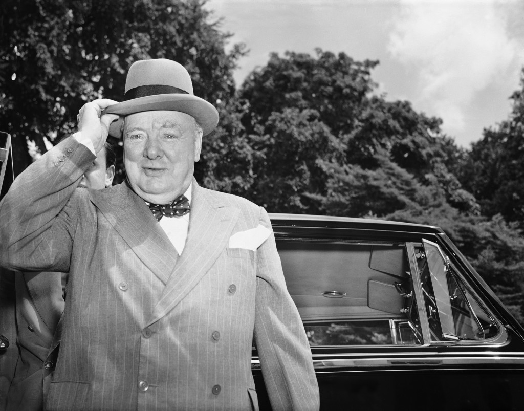 FILE - In this June 29, 1954 file photo, British Prime Minister Winston Churchill holds his hat as he arrives at the White House in Washington. Newly ...