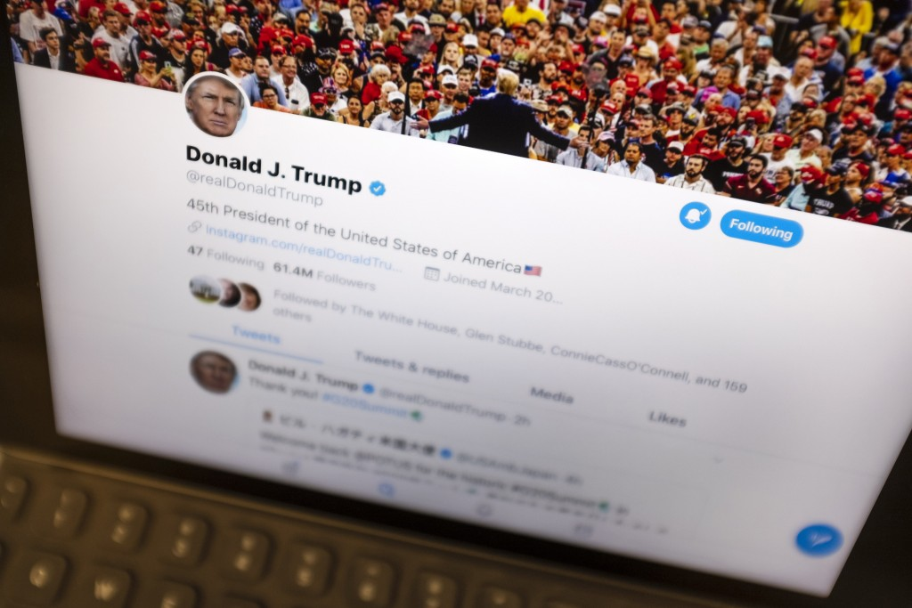 FILE - This June 27, 2019, file photo President Donald Trump's Twitter feed is photographed on an Apple iPad in New York. Trump's retweet of a post wi...