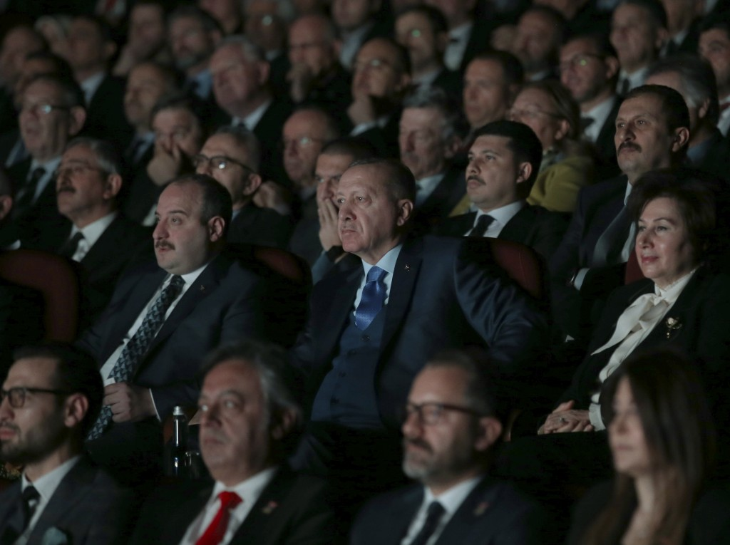 Turkey's President Recep Tayyip Erdogan centre, attends an event in Ankara, Turkey, Monday, Dec. 30, 2019. Turkey's government on Monday submitted a m...