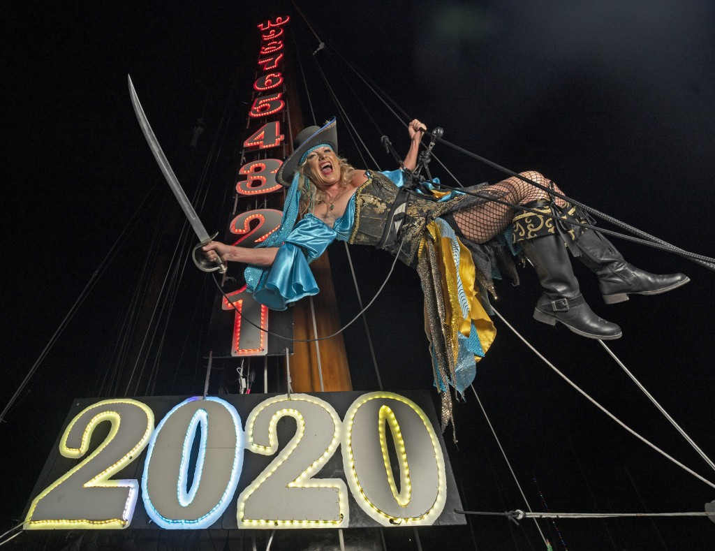 In this photo provided by the Florida Keys News Bureau, Evalena Worthington rehearses her New Year's Eve descent, costumed as a pirate wench, late Mon...