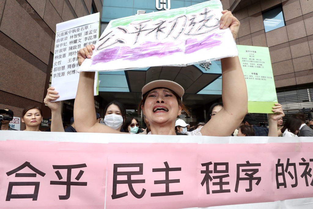Protesters rally outside DPP headquarters on May 22, 2019.