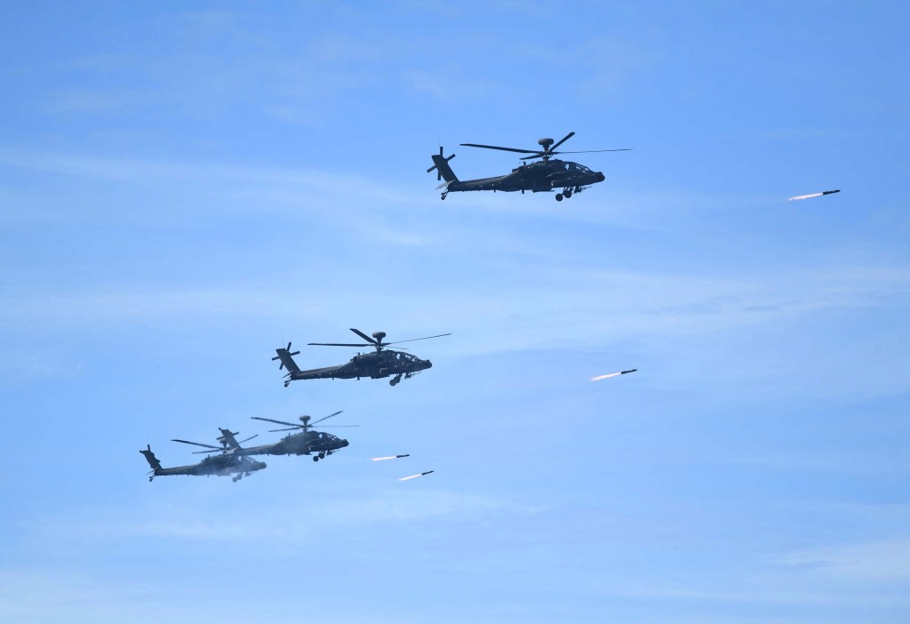 Apache helicopters firing Hellfire missiles during 2019 Han Kuang exercise.