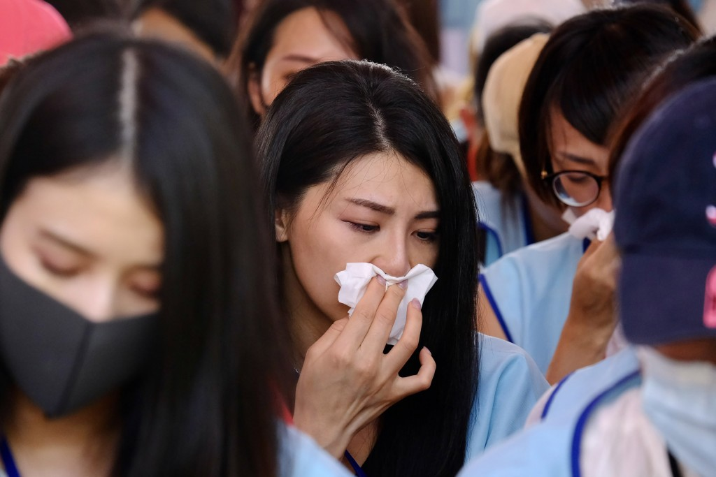 EVA Air flight attendants reacting with emotion to the result of the vote.
