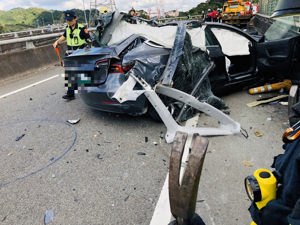 Tesla driver falls to death from ramp in New Taipei after car crash.