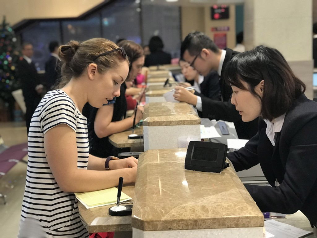 Bank staff instructing foreign clients in Taiwan.