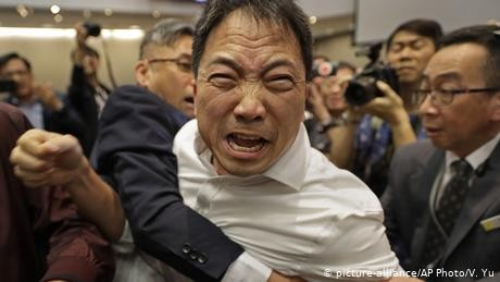 Hong Kong lawmakers brawl over controversial extradition bill
