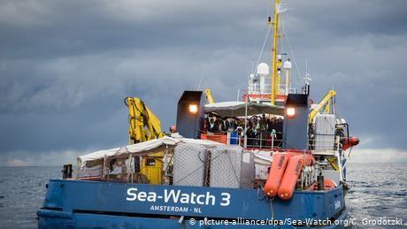 Mediterranean rescue ship brings migrants to Italy, defying Salvini