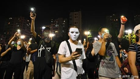 Hong Kong protesters break into small groups as police chase them