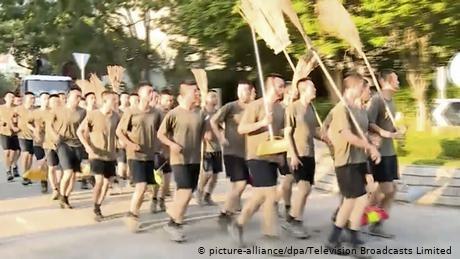 Chinese army 'volunteers' to help clean streets in Hong Kong