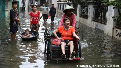 Indonesia braces for more floods as death toll hits 66