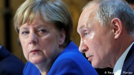 Putin invites Merkel to Russia over Iran crisis