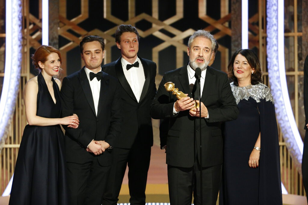 "This image released by NBC shows filmmaker Sam Mendes accepting the award for best motion picture drama for ""1917"" at the 77th Annual Golden..."