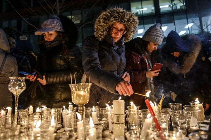 Members of Montreal's Iranian community attend a vigil, Jan. 9, 2019 in downtown Montreal.