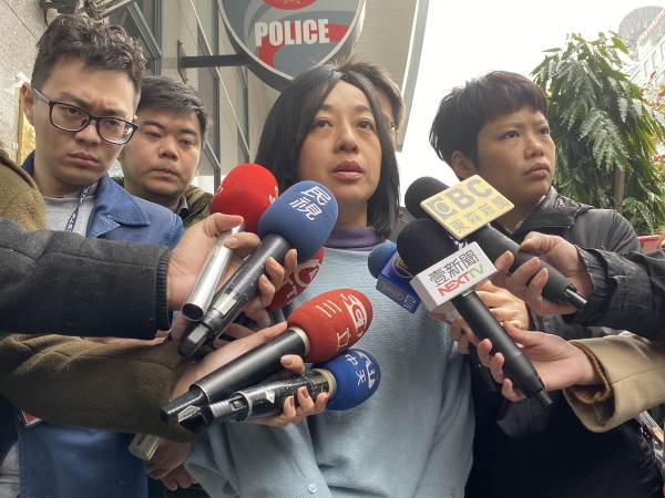 Claire Wang speaking to reporters.