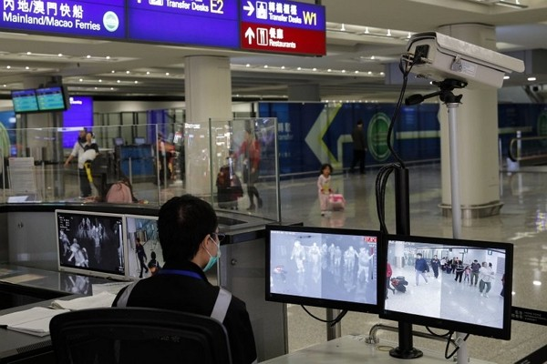 Authorities monitor passengers arriving from Wuhan.