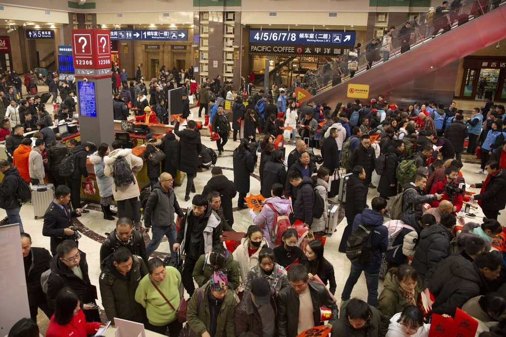 Chinese leaving on holiday at Beijing Railway Station Friday (Jan. 17).