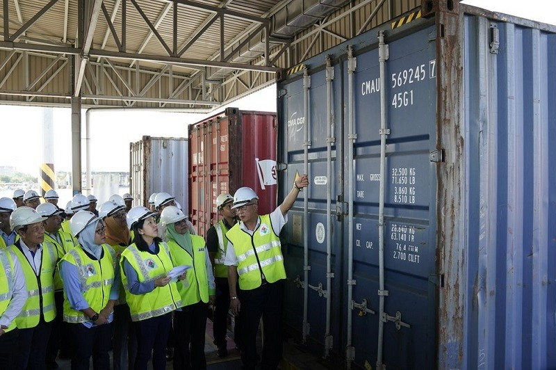 Malaysia's Environment Minister Yeo Bee Yin, third from left, inspects a container with plastic waste at a port in Butterworth, Malaysia, Monday, ...