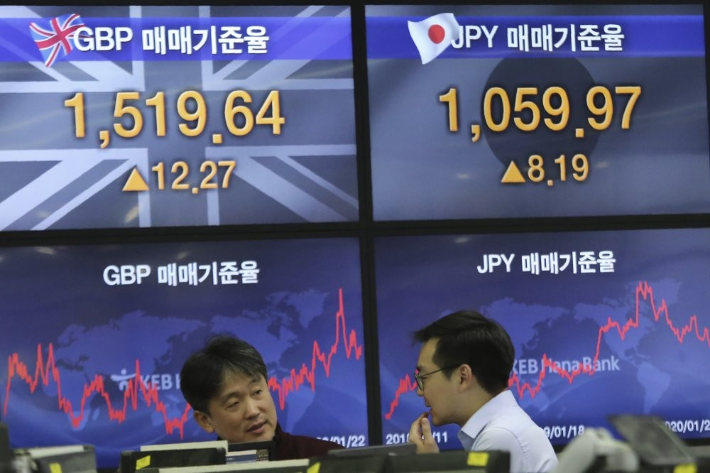 Currency traders in South Korea Wednesday.
