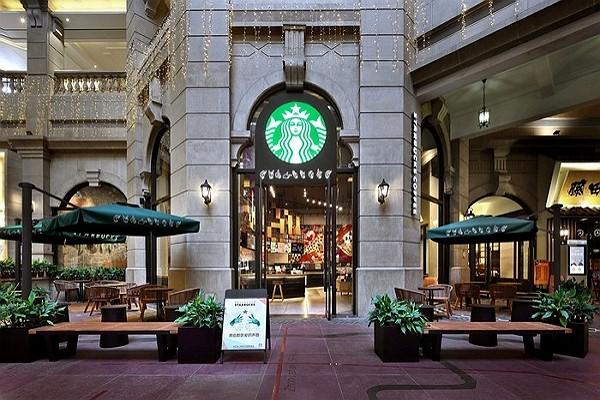 Starbucks shutters half its China stores, warns of hit from virus