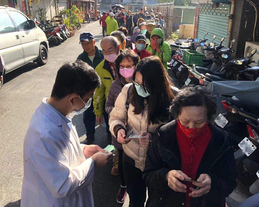 Long line for masks in front of pharmacy in Taipei.