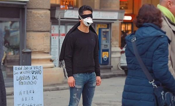 Massimiliano Martigli Jiang stands in silent protest. (Facebook video screenshot)