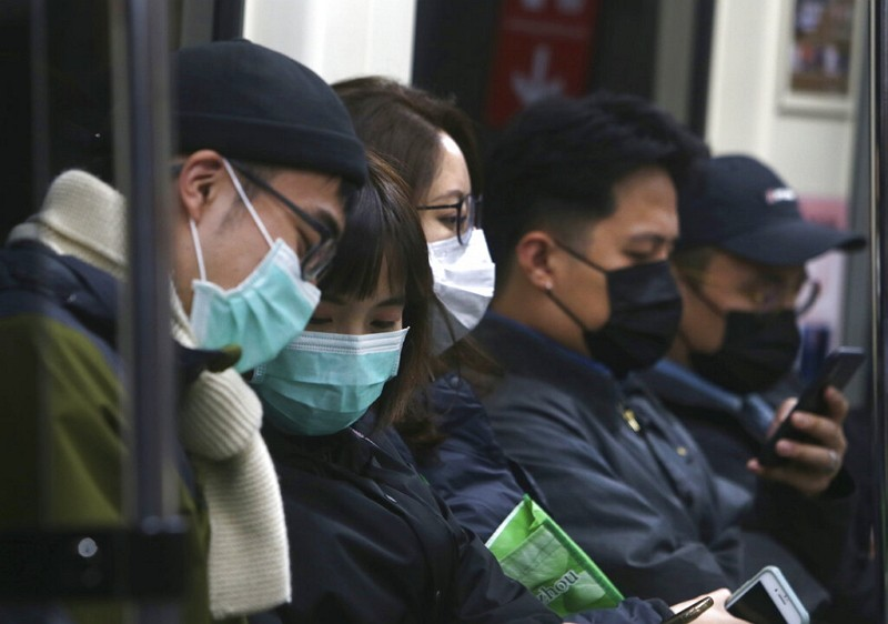 People in Taiwan wear protective face masks at a metro station in Taipei.
