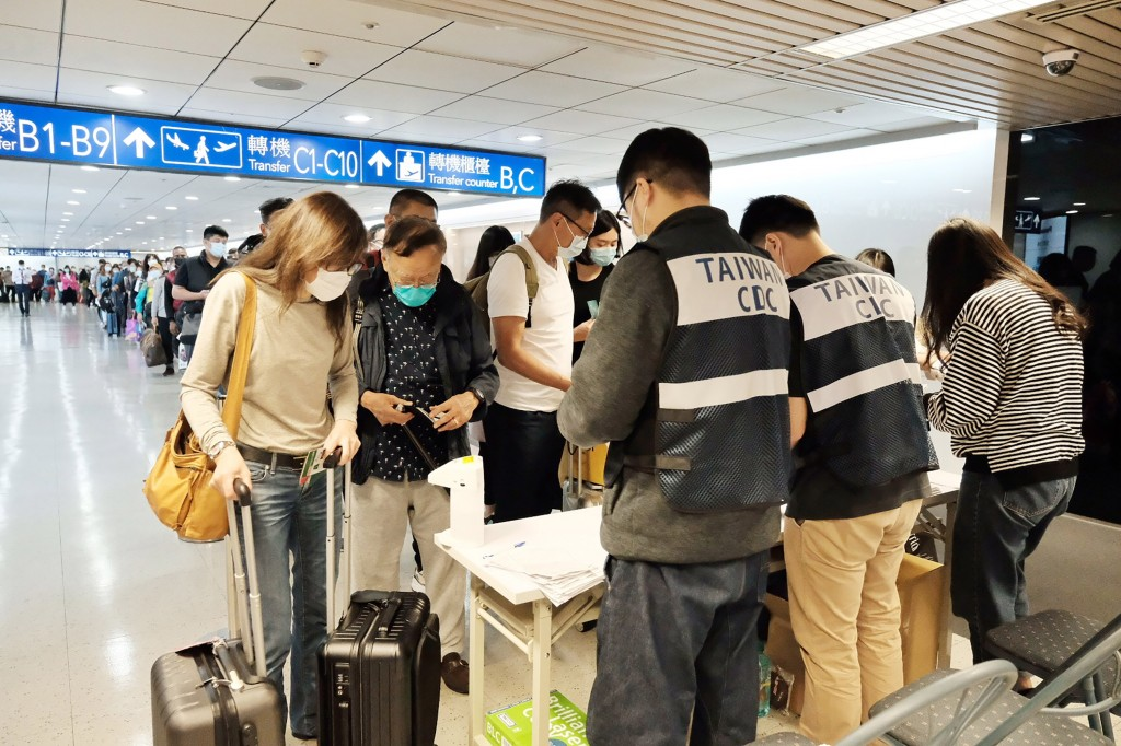 Passengers arriving at Taoyuan Airport.