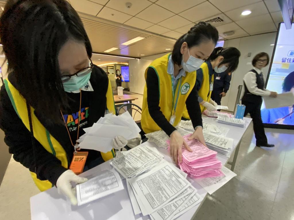 Preparing forms for arriving travelers at Taiwan Taoyuan International Airport.