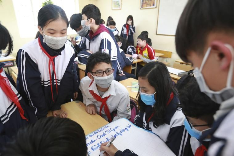 Students wear masks in during class at the Dinh Cong secondary school in Hanoi.