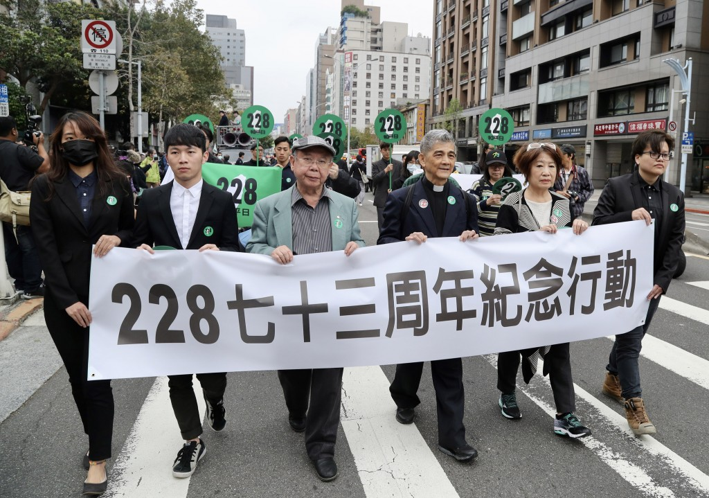 Activists march in Taipei to commemorate the 228 Incident on Feb. 22.