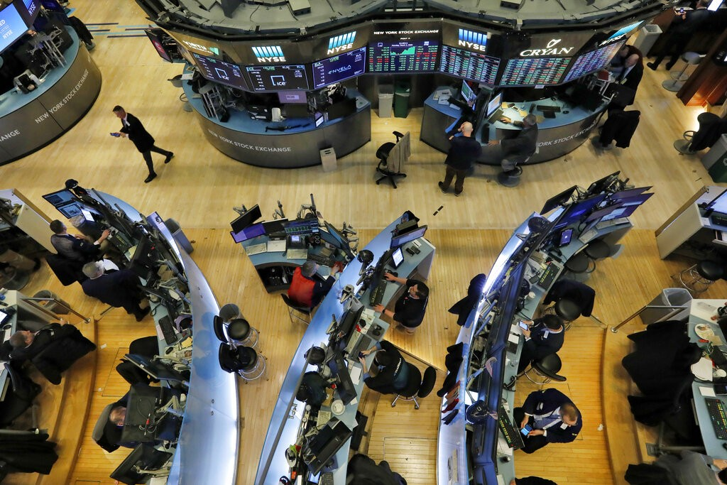 Traders work on the floor of the New York Stock Exchange, Monday, March 2, 2020. U.S. stocks are coming off their worst weekly drop since the financia...