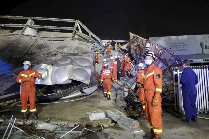 Rescuers work at the site of a collapsed five-story hotel building in Quanzhou city in southeast China's Fujian province Saturday, March 7, 2020.&...