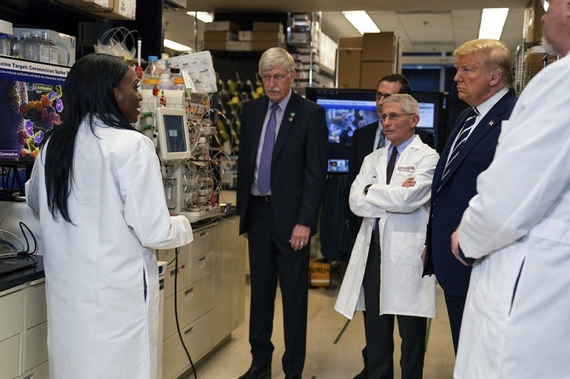 In this Tuesday, March 3, 2020 file photo, Dr. Kizzmekia Corbett, left, senior research fellow and scientific lead for coronavirus vaccines and immuno...